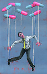 Illustrative image of man hanging from pills representing addiction to drugs