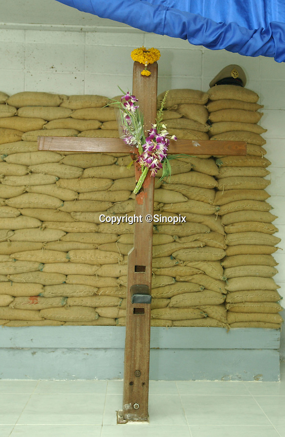 Thailand's  Bangkwang Central Prison execution chamber.  The  condemmed men are strapped to the wooden execution cross at the back of the room.  They are killed by machine gun.