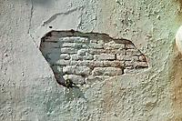Myanmar, Burma.  Mingun, near Mandalay.  Fallen Plaster Reveals Brick Construction Underneath, Wall Surrounding Bhuddist Stupa.