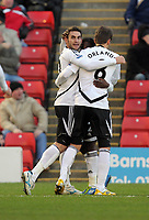 Pictured: Angel Rangel of Swansea (L) celebrating his equaliser with team mate Andrea Orlandi (R). Saturday 07 January 2012<br /> Re: FA Cup football Barnsley FC v Swansea City FC at the Oakwell Stadium, south Yorkshire.