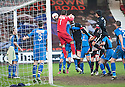 Pars' Ryan Thomson (11) beats Stranraer keeper David Mitchell to the ball to score their first goal.