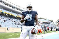 CHAPEL HILL, NC - OCTOBER 10: Michael Carter #8 of North Carolina celebrates after a 62-yard touchdown run during a game between Virginia Tech and North Carolina at Kenan Memorial Stadium on October 10, 2020 in Chapel Hill, North Carolina.