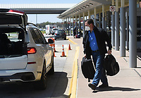 Randy Fox of Fayetteville loads his luggage into a car, Friday, April 2, 2021 at the Northwest Arkansas National Airport in Bentonville. Check out nwaonline.com/210403Daily/ for today's photo gallery. <br /> (NWA Democrat-Gazette/Charlie Kaijo)