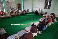 Imam and Madrasa Students doing their Lessons, Madrasa Imdadul Uloom, Dehradun, India.