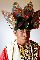 Wumu Village, Yulong County, Yunnan Province, China - Dongba priest He Jixian of the Naxi ethnic group wears his traditional priest costumes, June 2019.