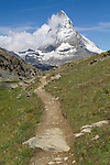 Matterhorn and hiking trail, above Zermatt, Switzerland. .  John leads hiking and photo tours throughout Colorado.