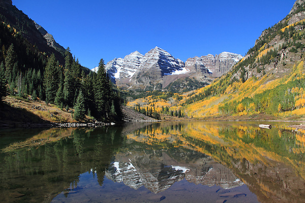 Autumn aspen trees at Maroon Lake with North and South Maroon Peaks, Maroon Bells, near Aspen, Colorado, USA .  John leads private photo tours throughout Colorado. Year-round Colorado photo tours.