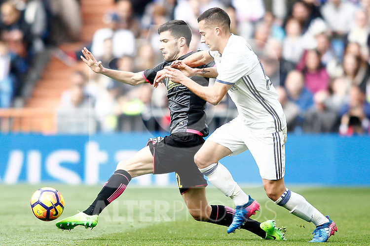 Real Madrid's Lucas Vazquez (r) and RCD Espanyol's Aaron Martin during La Liga match. February 18,2017. (ALTERPHOTOS/Acero)