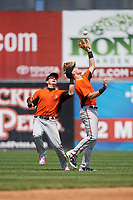 Frederick Keys shortstop Ryan Mountcastle (6) catches a shallow fly ball in front of center fielder Austin Hays (18) during the first game of a doubleheader against the Wilmington Blue Rocks on May 14, 2017 at Daniel S. Frawley Stadium in Wilmington, Delaware.  Wilmington defeated Frederick 10-2.  (Mike Janes/Four Seam Images)