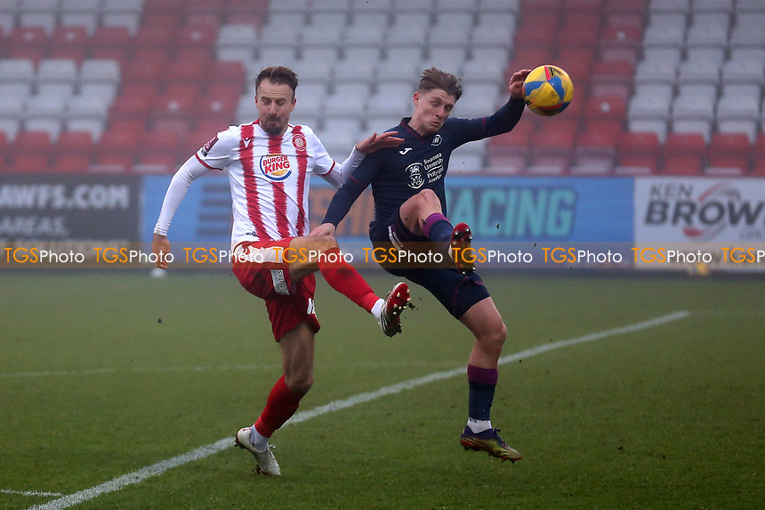 Chris Lines of Stevenage and George Byers of Swansea City during Stevenage vs Swansea City, Emirates FA Cup Football at the Lamex Stadium on 9th January 2021