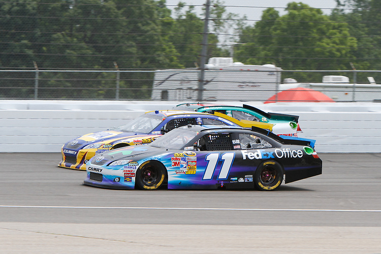 19 June, 2011: Denny Hamlin runs three-wide out of turn two during the 43rd Annual Heluva Good! Sour Cream Dips 400 at Michigan International Speedway in Brooklyn, Michigan. (Photo by Jeff Speer :: SpeerPhoto.com)