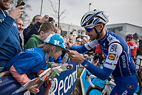 E3 victory champion (with 5 wins) Tom Boonen (BEL/Quick-Step Floors) signing a young boys cap at the start of his last E3<br /> <br /> <br /> 60th E3 Harelbeke (1.UWT)<br /> 1day race: Harelbeke › Harelbeke - BEL (206km)