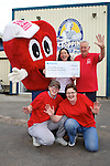 Pix: Shaun Flannery/shaunflanneryphotography.com...COPYRIGHT PICTURE>>SHAUN FLANNERY>01302-570814>>07778315553>>..29th June 2011..................The Topping Pie Company, Doncaster present a cheque for £2,000 to the British Heart Foundation (BHF), raised through a sponsored cycle ride..Pictured with the BHF mascot Mr Hearty are L-R (back) Lynda Povey, General Manager of Toppings, Derek Spence, BHF (front) Laura Rae and Julie Huxtable of Toppings.