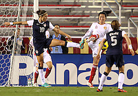 BOCA RATON, FL - DECEMBER 15, 2012: Carli Lloyd (10) of the USA WNT pushes the ball away from Pu Wei (11) of China WNT during an international friendly match at FAU Stadium, in Boca Raton, Florida, on Saturday, December 15, 2012. USA won 4-1.