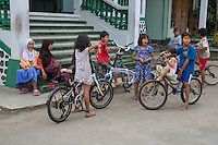 Borobudur, Java, Indonesia.  Javanese Children and their Bicycles in front of Village Mosque.