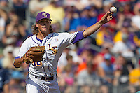 Louisiana State pitcher Chris Cotton (58) makes a pickoff throw to first base against the North Carolina Tar Heels during Game 7 of the 2013 Men's College World Series on June 18, 2013 at TD Ameritrade Park in Omaha, Nebraska. The Tar Heels defeated the Tigers 4-2, eliminating LSU from the tournament. (Andrew Woolley/Four Seam Images)