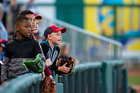 Young fans watch from the seats on May 4, 2019, at Arvest Ballpark in Springdale, Arkansas. (Jason Ivester/Four Seam Images)
