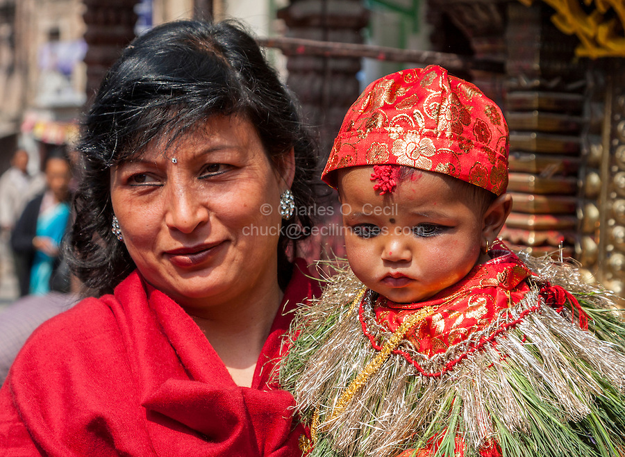 Nepal, Kathmandu.  Celebrating a six-month-old boy's eating rice for the first time, his family brings him to the Ashok Binayak (Maru Ganesh) Temple for a Blessing.