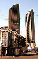 San Diego: View southwest from 5th & J St. at noon, Jan. 1992. Twin Towers in background.