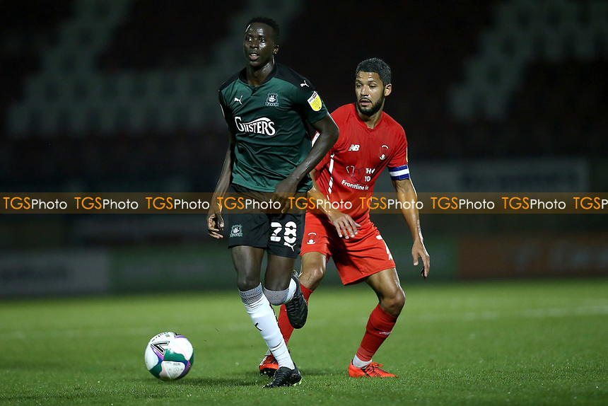 Jobi McAnuff of Leyton Orient  and Panutche Camara of Plymouth Argyle during Leyton Orient vs Plymouth Argyle, Caraboa Cup Football at The Breyer Group Stadium on 15th September 2020