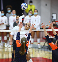 Arkansas Senior Ellease Crumpton (6) goes up for spike as Ellease Crumpton (6) and Natalie Perdue (19) go up for block on Sunday, Oct. 10, 2021, during play at Barnhill Arena, Fayetteville. Visit nwaonline.com/211011Daily/ for today's photo gallery.<br /> (Special to the NWA Democrat-Gazette/David Beach)