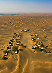 Pictured: Aerial photographs show a desert ghost town.<br /> <br /> Rumours abound as to why the people of the Al Kutbi tribe fled their homes, but doors left open and possessions left behind suggest they fled in a hurry.<br /> <br /> The eerie town of Al Madam is an hour drive from Dubai, in the United Arab Emirates, and it is understood it was built in the 1970s and abandoned in the '80s.   It has been suggested inhabitants may have fled after believing they were being targeted by a 'devil creature' while others say they were forced out by a succession of sandstorms.   SEE OUR COPY FOR DETAILS<br /> <br /> Please byline: Erik Krugers/Solent News<br /> <br /> © Erik Krugers/Solent News & Photo Agency<br /> UK +44 (0) 2380 458800