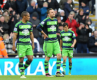 Swansea City players look on dejected after conceding a goal during the Barclays Premier League match between Newcastle United and Swansea City played at St. James' Park, Newcastle upon Tyne, on the 16th April 2016
