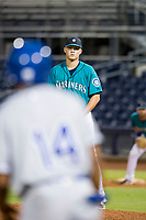 AZL Mariners relief pitcher Cody Mobley (30) looks towards third base before delivering a pitch against the AZL Royals on July 29, 2017 at Peoria Stadium in Peoria, Arizona. AZL Royals defeated the AZL Mariners 11-4. (Zachary Lucy/Four Seam Images)