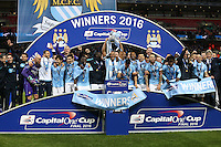 Manchester City players celebrate after winning the Capital One Cup by beating Liverpool on penalties at Wembley Stadium, London, England on 28 February 2016. Photo by David Horn / PRiME Media Images.
