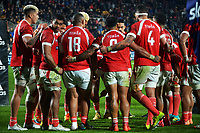 The Tingan team huddles behind the goalposts after the All Blacks pass the 100-point mark during the Steinlager Series rugby match between the New Zealand All Blacks and Tonga at Mt Smart Stadium in Auckland, New Zealand on Saturday, 3 July 2021. Photo: Dave Lintott / lintottphoto.co.nz