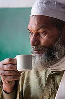 India, Dehradun.  Indian Man Enjoying a Cup of Coffee.