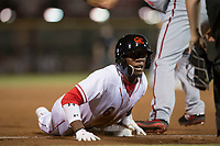 Scottsdale Scorpions second baseman Shed Long (6), of the Cincinnati Reds organization, waits for the umpire's decision after sliding into third base during an Arizona Fall League game against the Salt River Rafters at Scottsdale Stadium on October 12, 2018 in Scottsdale, Arizona. Scottsdale defeated Salt River 6-2. (Zachary Lucy/Four Seam Images)