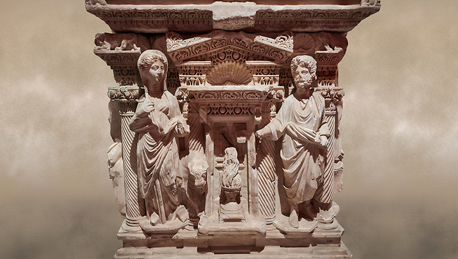 """Roman relief sculpted sarcophagus of Domitias Julianus and Domita Philiska, 2nd century AD, Perge. Antalya Archaeology Museum, Turkey.<br /> <br /> <br /> it is from the group of tombs classified as. """"Columned Sarcophagi of Asia Minor"""". <br /> The lid of the sarcophagus is sculpted into the form of a """"Kline"""" style Roman couch on which lie Julianus &  Philiska. This type of Sarcophagus is also known as a Sydemara Type of Tomb.. Against a warm art background."""