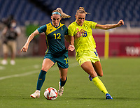 TOKYO, JAPAN - JULY 24: Ellie Carpenter #12 of Australia fights for the ball with Fridolina Rolfo #18 of Sweden during a game between Australia and Sweden at Saitama Stadium on July 24, 2021 in Tokyo, Japan.