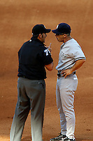 New York Yankees Manager Joe Girardi #28 argues a call by third base umpire Manny Gonzalez during a game against the Los Angeles Angels at Angel Stadium on June 15, 2013 in Anaheim, California. (Larry Goren/Four Seam Images)