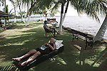 A couple relaxes by the backwaters in a luxurious resort in Alleppey, Kerala, India.