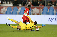 TORONTO, ON - OCTOBER 15: Zack Steffen #1 GK of the USA defends against an advancing Jonathan David #20 of Canada during a game between Canada and USMNT at BMO Field on October 15, 2019 in Toronto, Canada.