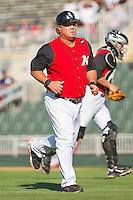 Kannapolis Intimidators manager Tommy Thompson #39 jogs off the field after having a chat with his pitcher during the South Atlantic League game against the Hickory Crawdads at Fieldcrest Cannon Stadium on April 17, 2011 in Kannapolis, North Carolina.   Photo by Brian Westerholt / Four Seam Images