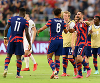 AUSTIN, TX - JULY 29: Nicholas Gioacchini #8 and Sebastian LLetget #17 of the United States celebrates their win after a game between Qatar and USMNT at Q2 Stadium on July 29, 2021 in Austin, Texas.