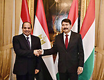 Egyptian President Abdel Fattah al-Sisi shakes hands with Hungary's President Janos Ader at the presidental palace in Budapest, Hungary, on October 12, 2021 during his welcoming ceremony. Photo by Egyptian President Office