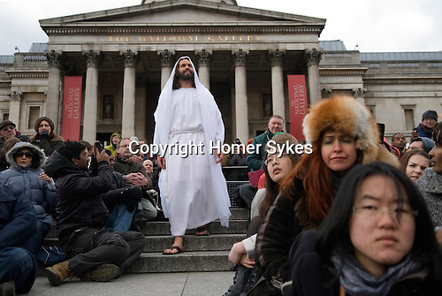 """Good Friday, Passion Play """"Passion in the Square"""" Trafalgar Square thousands gather to watch annual performance by the Wintershall Players. London UK. James Burke-Dunsmore play the lead role in the play """"The Passion of Jesus"""". Young woman, overcome with emotion as she watches the performance on the large screen. 29th March 2013."""
