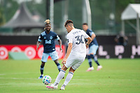 LAKE BUENA VISTA, FL - JULY 23: Gaston Gimenez #30 of the Chicago Fire kicks the ball during a game between Chicago Fire and Vancouver Whitecaps at Wide World of Sports on July 23, 2020 in Lake Buena Vista, Florida.