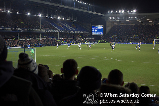 Everton 0 West Bromwich Albion 0, 19/01/2015. Goodison Park, Premier League. Home supporters in the Gwladys Street stand watching the second-half at Goodison Park, Liverpool of the Premier League match between Everton and West Bromwich Albion. The match ended in a 0-0 draw, despite the home team missing a first-half penalty by Kevin Mirallas. The game was watched by 34,739 spectators and left both teams languishing near the relegation zone. Photo by Colin McPherson.
