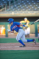 AZL Rangers Cody Freeman (33) hits a single up the middle during an Arizona League game against the AZL Athletics Gold on July 15, 2019 at Hohokam Stadium in Mesa, Arizona. The AZL Athletics Gold defeated the AZL Rangers 9-8 in 11 innings. (Zachary Lucy/Four Seam Images)