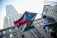 NEW YORK, NY - JUNE 15: A Pro-Palestinian man holds a flagpole next to the Empire State Building during a large protest in New York on June 15, 2021. The solidarity action of hundreds of pro-Palestinians is a form of support against the attacks carried out by the Israeli government. At the same time, Palestinian Prime Minister Mohammad Shtayyeh says the new Israeli government is just as bad as the old one and condemns Naftali Bennett's announcements in support of Israeli settlements. That is why the demonstrations continue in different parts of the world. (Photo by Pablo Monsalve / VIEWpress via Getty Images