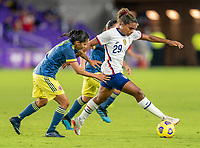 ORLANDO, FL - JANUARY 22: Carolina Arias #17 of Colombia fights for the ball with Catarina Macario #29 of the USWNT during a game between Colombia and USWNT at Exploria stadium on January 22, 2021 in Orlando, Florida.