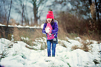 Michaela Adamson,5 play in the fresh snow in the village of Coelbren in the Swansea Valley in South Wales.