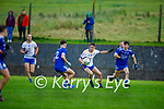 Sean Corcoran of Keel tries to advance with the ball as  Joe Hoare of Annascaul closes down his path in the Junior Premier football championship