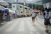 a 'walking-not-riding' Alexis Gougeard (FRA/Ag2r-La Mondiale) after the finish line; his derailleur broke down and that frustrated him clearly<br /> <br /> Stage 18 (ITT) - Sallanches › Megève (17km)<br /> 103rd Tour de France 2016