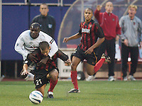Chris Gbandi of the Burn got a yellow card for this NFL style tackle of Craig Ziadie. The Dallas Burn were defeated by the NY/NJ MetroStars 2-1 on 5/24/03 at Giant's Stadium, East Rutherford, NJ.